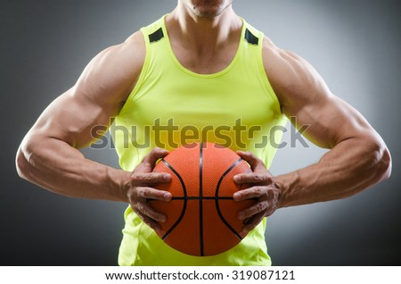Muscular basketball in sports concept - stock photo