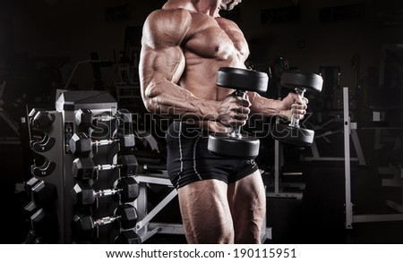 muscular body building men training at the gym - stock photo