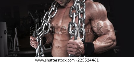 muscular body building men training with chain at the gym  - stock photo