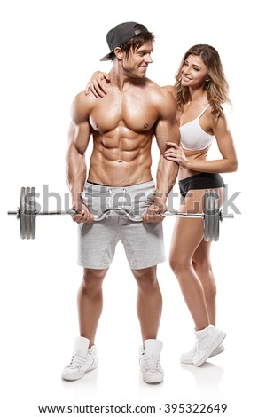 Muscular bodybuilder guy with woman doing exercises with dumbbells over white background - stock photo