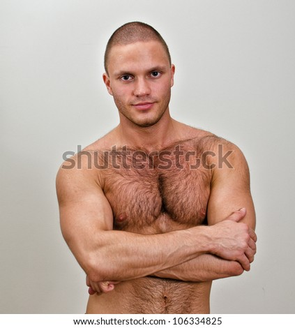 Muscular bodybuilder torso. On grey background. - stock photo