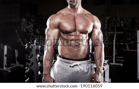 muscular bodybuilding men at the gym - stock photo