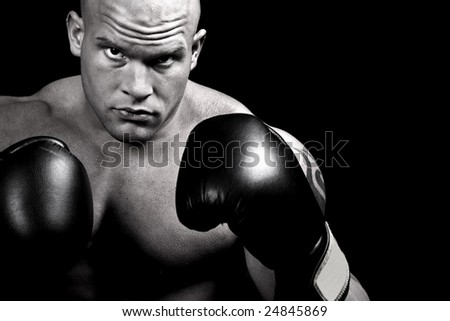 Muscular boxer-desaturated and isolated on black background