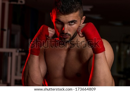 Muscular Boxer MMA Fighter Practice His Skills - stock photo