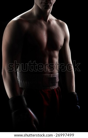 Muscular boxer on black - stock photo