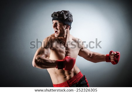Muscular boxer wiith red gloves - stock photo