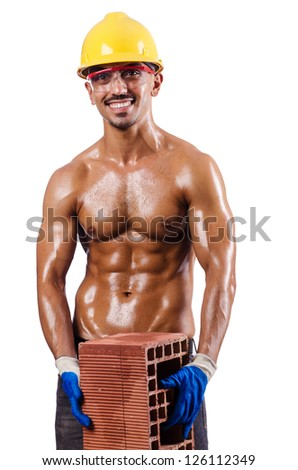 Muscular builder with bricks on white