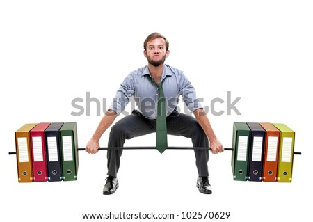Muscular businessman lifting weights made of heavy files - stock photo