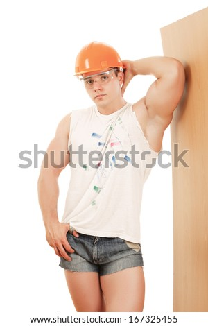 Muscular construction worker posing - stock photo