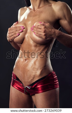 Muscular female body with sweat, workout. Bodybuilding and fitness - stock photo