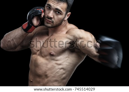 Muscular fighter, isolated on black background