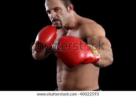 Muscular fighter portrait against black background