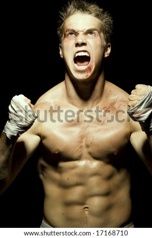 Muscular Fighter Screaming - stock photo