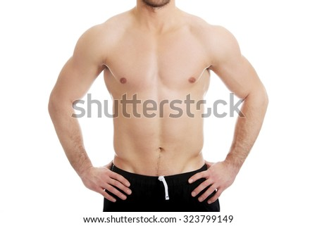 Muscular fit athletic male chest. - stock photo