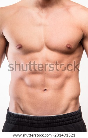 Muscular fitness man torso with six pack  - stock photo