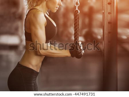 Muscular fitness woman doing exercises.Concept of healthy lifestyle. Cross fit bodybuilder  in the gym. - stock photo