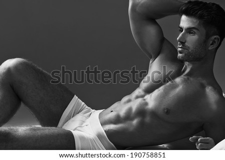 Muscular handsome sexy guy posing - stock photo