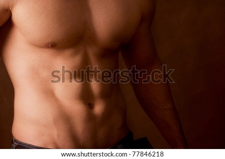 Muscular male body - stock photo