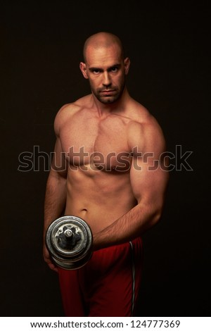 Muscular male body on black background