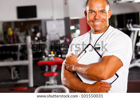 muscular male gym trainer portrait - stock photo