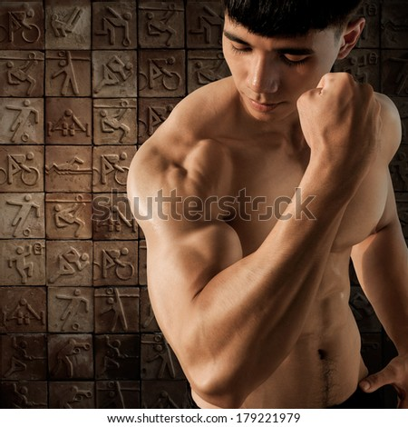 Muscular male on ceramic mosaic background.
