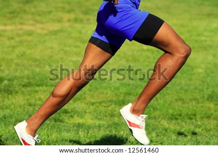 muscular male runner legs - stock photo