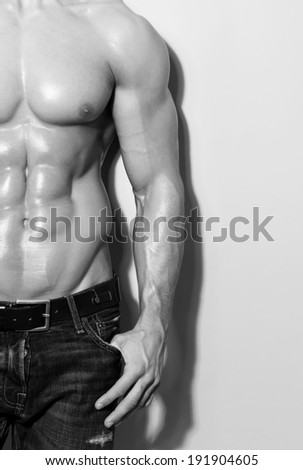 muscular male torso in black and white