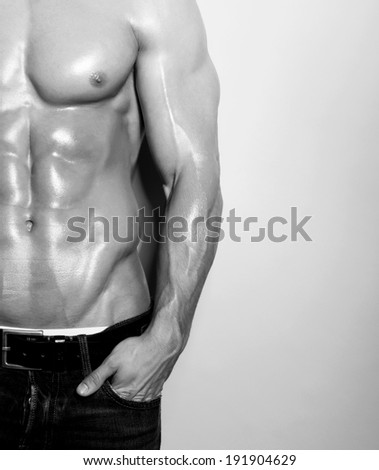 muscular male torso in black and white - stock photo