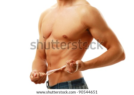 Muscular male torso is being measured isolated on white background - stock photo