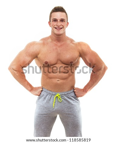 Muscular male torso of bodybuilder, studio shot - stock photo