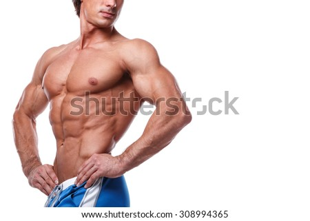 Muscular male torso over white background - stock photo