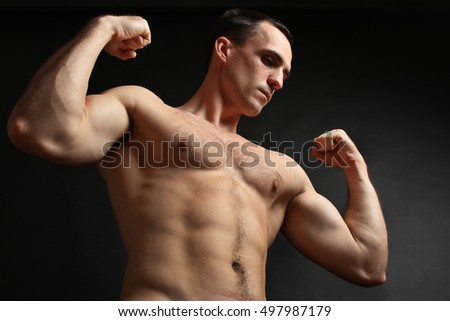 Muscular male torso. Perfect fit, shoulders, deltoids, biceps, triceps and chest.