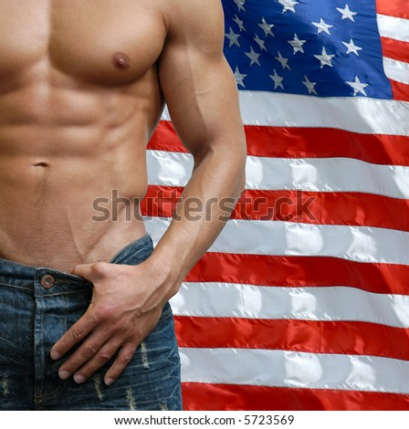 Muscular male torso with US flag behind - stock photo