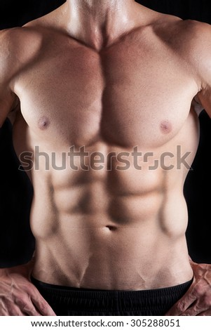 Muscular male with storng abdominal muscles - stock photo