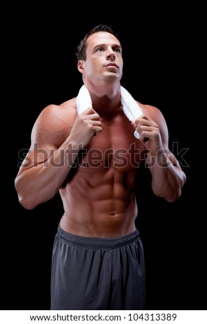 Muscular Male with towel around neck - stock photo