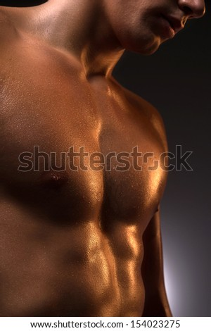 Muscular man. Close-up of muscular man standing isolated on white - stock photo