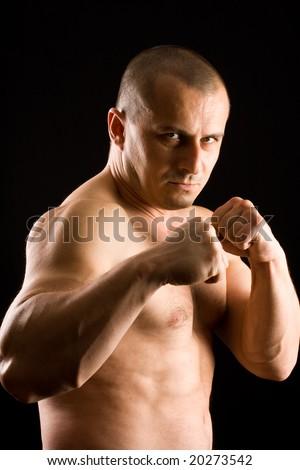 muscular man fighting - stock photo