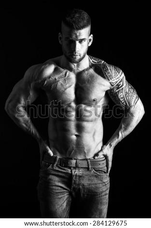 Muscular man - half-length, black and white photo - stock photo