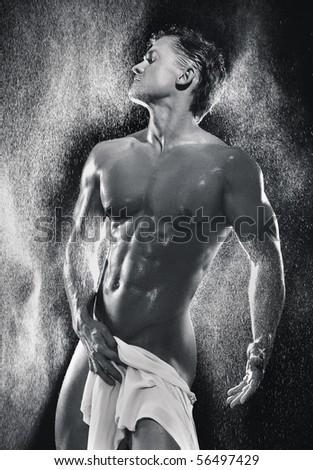 Muscular man having shower - stock photo