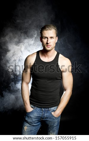Muscular man in back t-shirt - stock photo