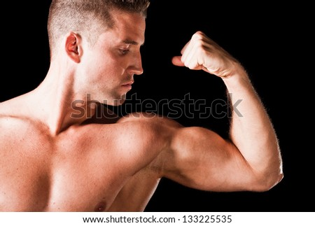 Muscular man isolated on black background - stock photo