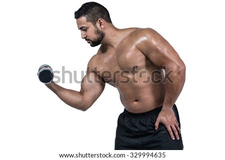 Muscular man lifting heavy dumbbell on white background