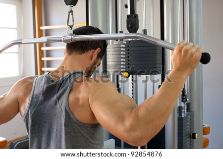 Muscular man lifting weights. - stock photo