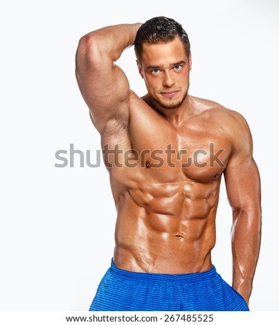Muscular man on white background - stock photo