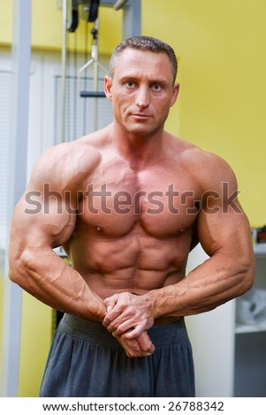 Muscular man posing in the fitness - stock photo