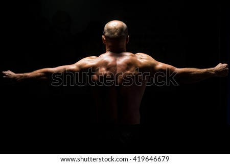Muscular Man Praying - Spiritual Concentration Concept - Back View