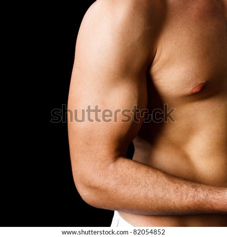 Muscular man showing biceps