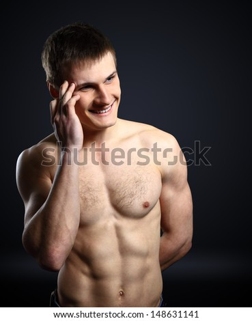 Muscular man showing his strong biceps