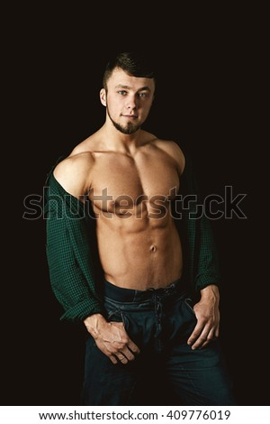 muscular man shows his body