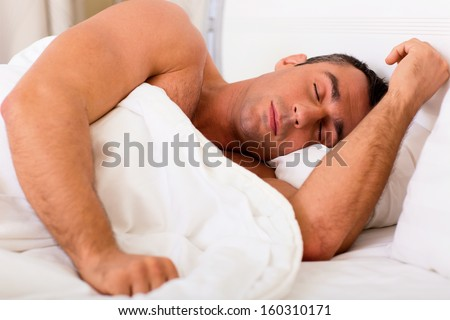 Muscular man sleeping at home